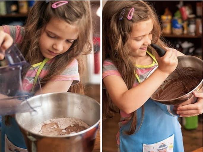 Child stirring cupcake batter in a bowl