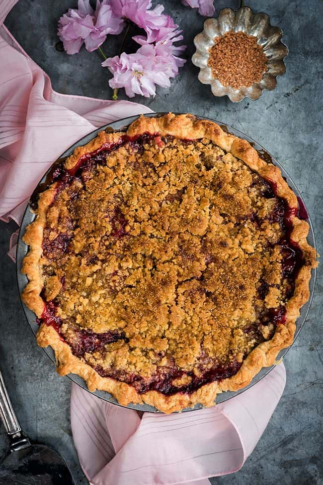 This rhubarb and raspberry pie with crumble topping walks the perfect line between sweet and tangy. Serve with vanilla ice cream for a slice of heaven!