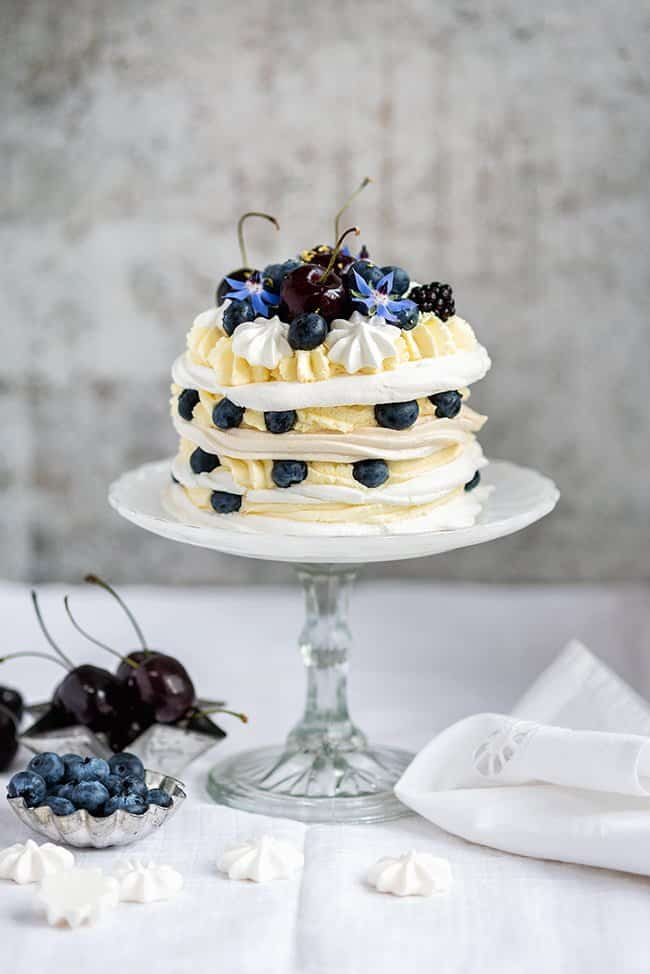 Meringue Stack Cake with Whipped Cream, Lemon Curd, and Berries