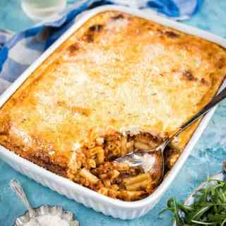 Greek Pastitsio recipe - this mince and pasta bake with cheese sauce combines macaroni and cheese with pasta bolognese for a dish that will be a hit with the entire family.