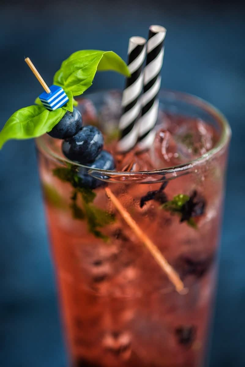 Give your Moscow Mule a spring update with muddled blueberries and basil – refreshing and delicious!