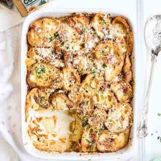 This savoury croissant pudding with Comté cheese and bacon is perfect for feeding a crowd on special occasions! Perfect for breakfast or brunch.