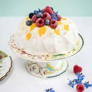 How to make the perfect Pavlova – read my 'pavlova how to' for perfect results every time! Plus a recipe for Pavlova crowns with whipped cream, lemon curd and fresh berries.