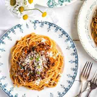 Make a big batch of this best-ever bolognese sauce to serve throughout the week. Made with frozen mince, this is budget friendly as well as totally delicious!