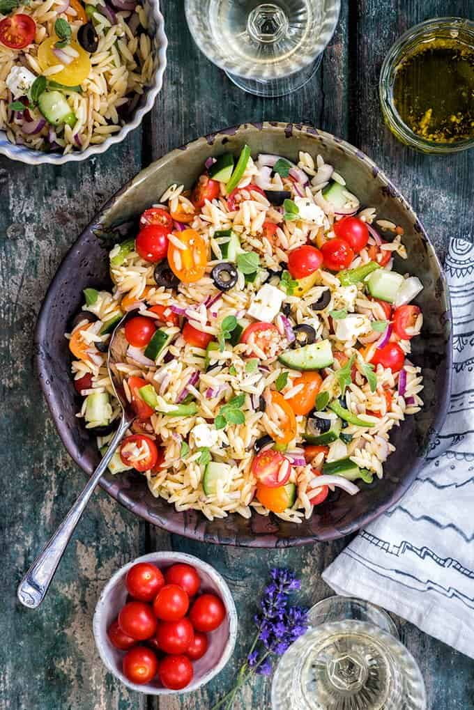 This summery Greek orzo pasta salad with tomatoes and feta will be your go-to side dish for barbecues and is also perfect for picnics and packed lunches.