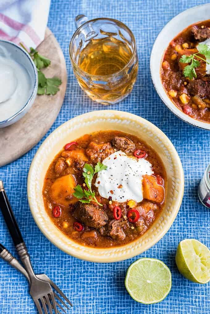 This delicious Tex-Mex beef stew with sweet potatoes is perfect whatever the season! Serve over rice with sour cream and lime wedges on the side.
