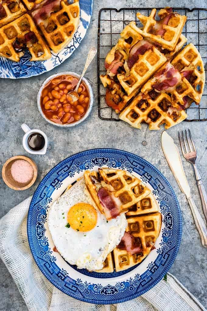 Take savoury waffles to the next level with these insanely delicious egg, cheddar and bacon breakfast waffles. #breakfast #bacon #waffles