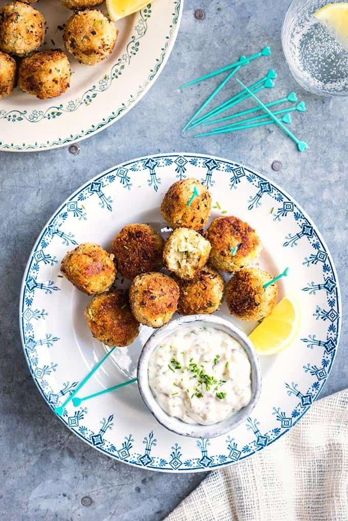 These herby fish croquettes, made with cod, haddock and salmon, are delicious served with easy tartar sauce. Kids and adults will love them! | Supergolden Bakes