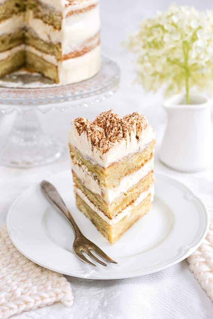 This Tiramisu naked cake with mascarpone frosting is creamy, rich and has a bit of a kick! Well Tiramisu means 'pick me up' after all...