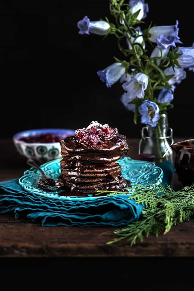 These chocolate pancakes with cranberry compote and chocolate sauce are the ultimate indulgence – perfect for a festive and delicious treat | Supergolden Bakes