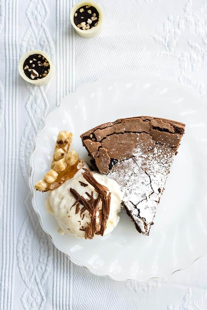 Gluten-free chocolate hazelnut torte - a truly heavenly yet easy dessert that's sure to wow especially when served with white chocolate praline no-churn ice cream! #dessert #glutenfree #chocolate #praline #icecream