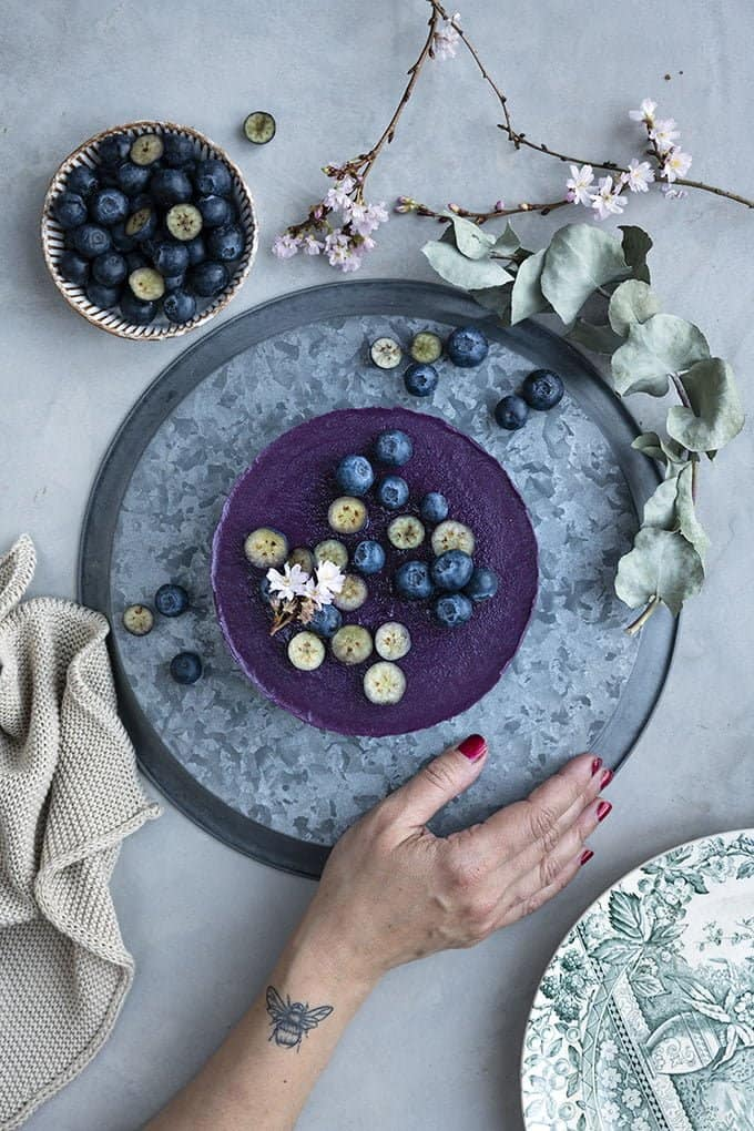 Start preparing your raw vegan blueberry smoothie cake the day before and allow time for it to set in the freezer.