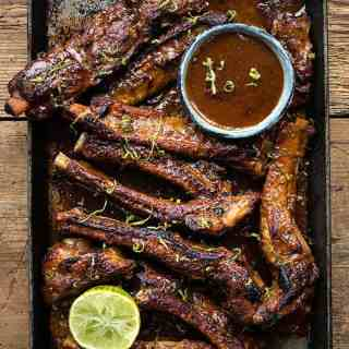 Sticky Korean pork ribs in tray overnead view