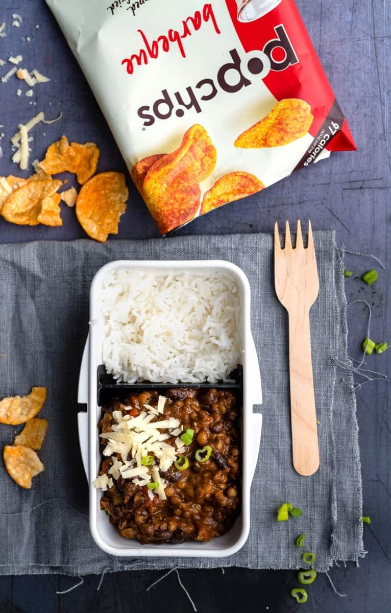 Lunch box containing vegetarian chili and rice