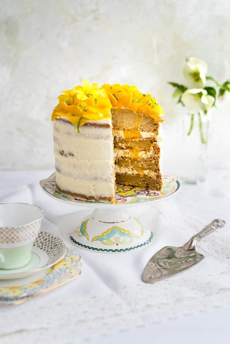 Beautiful vegan tropical celebration cake with slice taken out