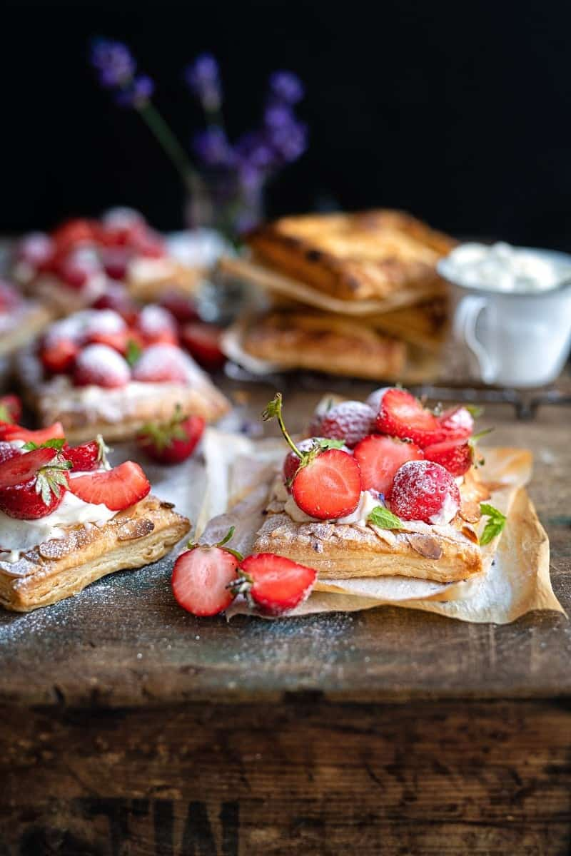 Strawberry puff pastry tarts dusted with icing sugar