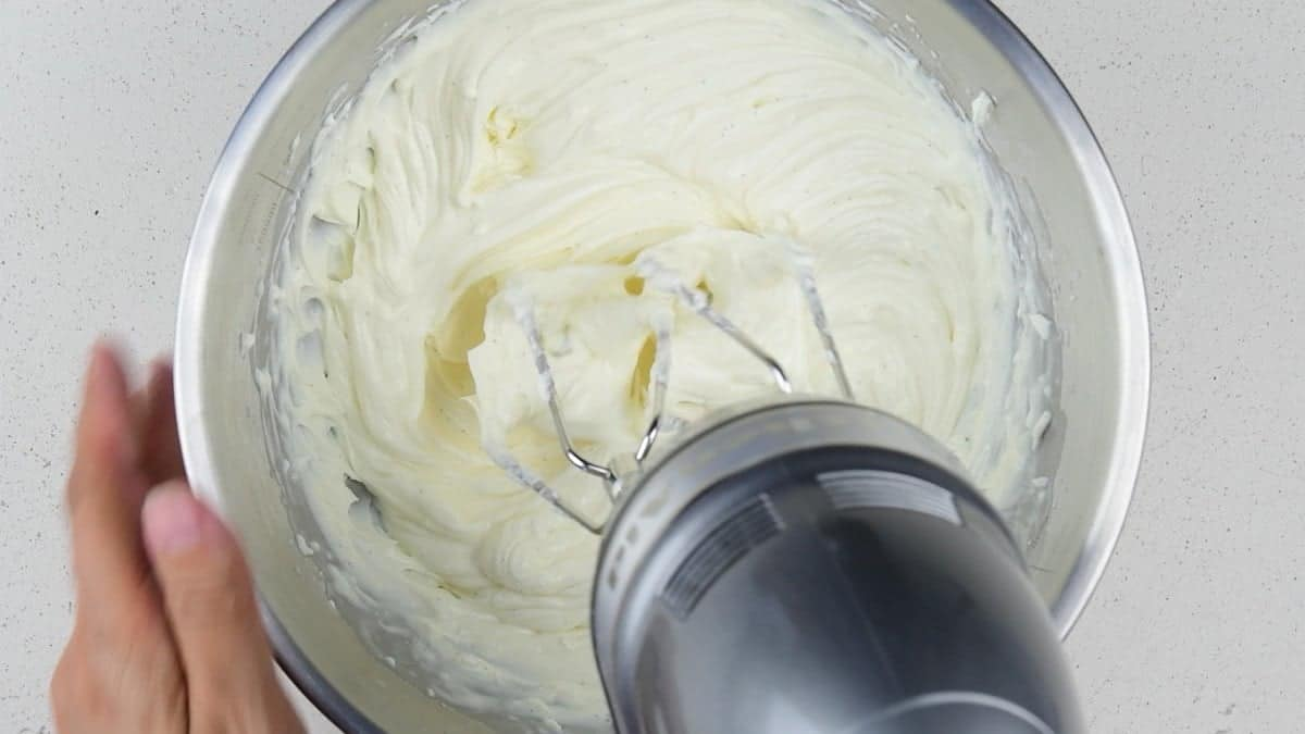 Whisking mascarpone for the tart filling