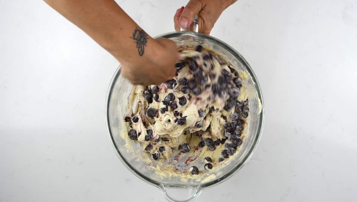 Fold blueberries into the cake batter