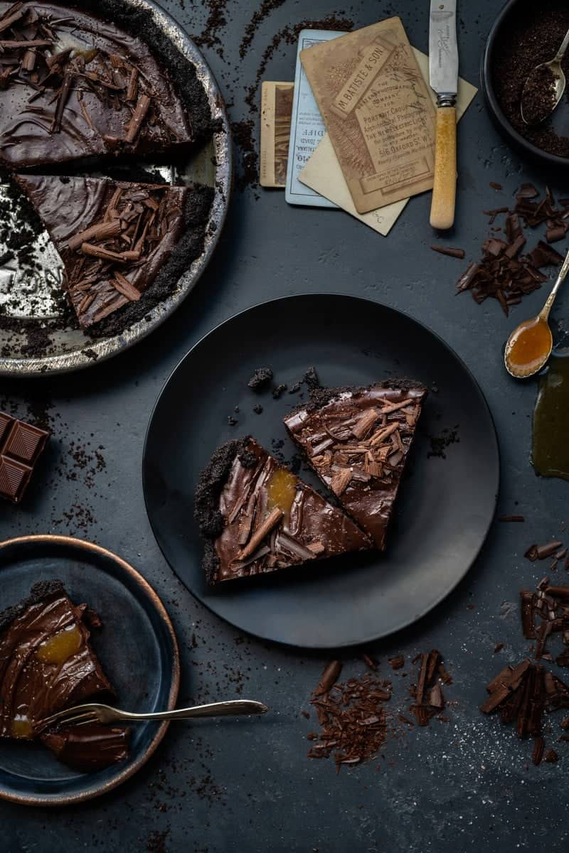 Slices of vegan chocolate tart on a place