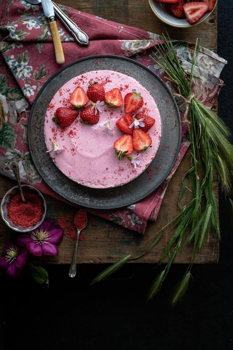 no-bake strawberry cheesecake decorated with fresh strawberries shown overhead