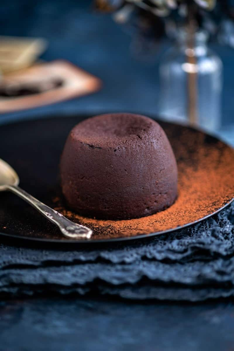 Molten lava cakes prepared in a pressure cooker served simply dusted with cocoa powder