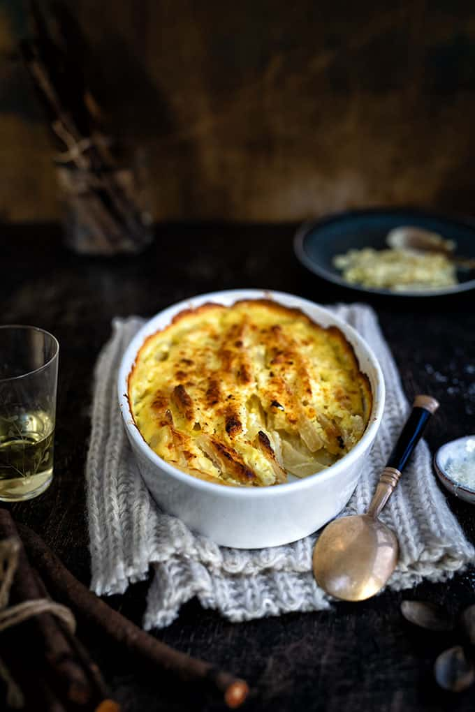Root vegetable gratin in an oval dish
