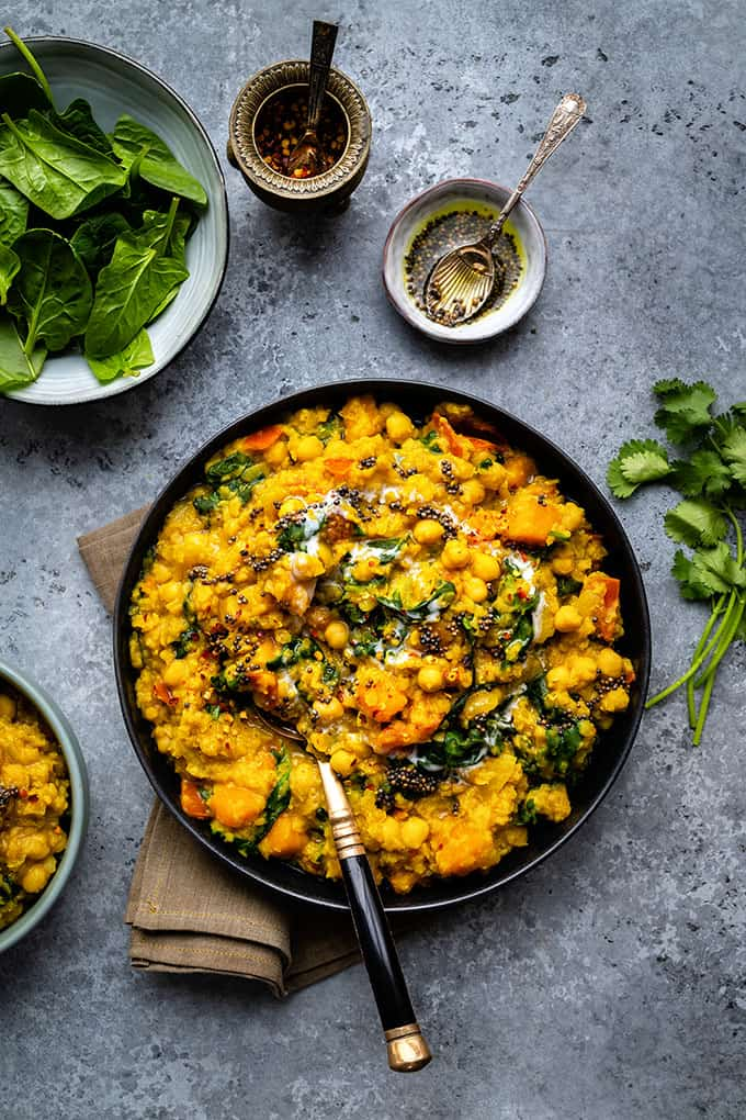 Vegan dal with red lentils, squash, chickpeas and spinach in a large bowl