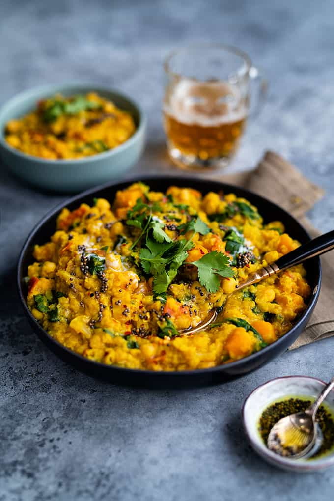 Vegan dhal curry with red lentils, squash, chickpeas and spinach