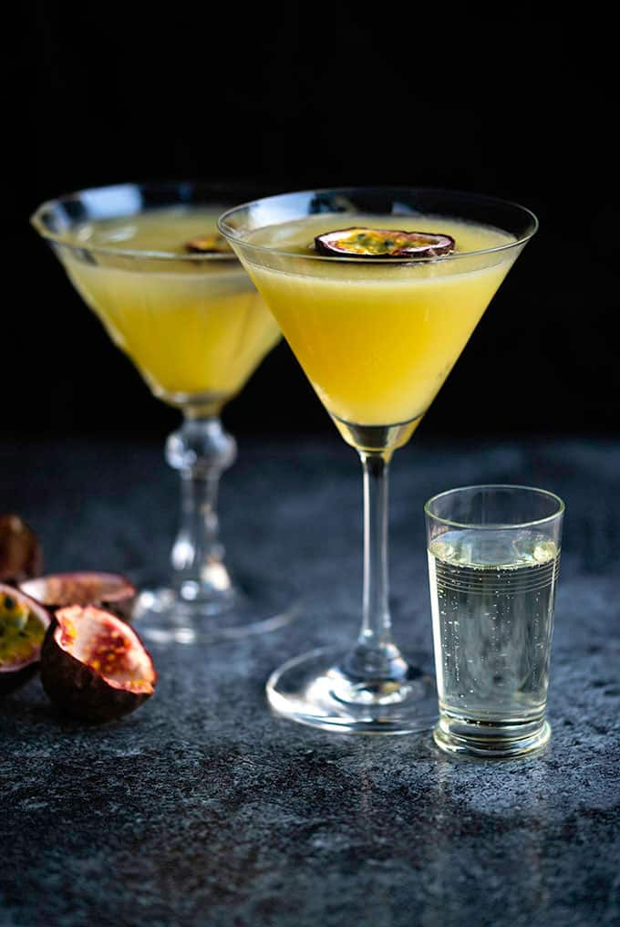 Two glasses of Passion Star Martini also known as Maverick Martini made with vodka and passion fruit l