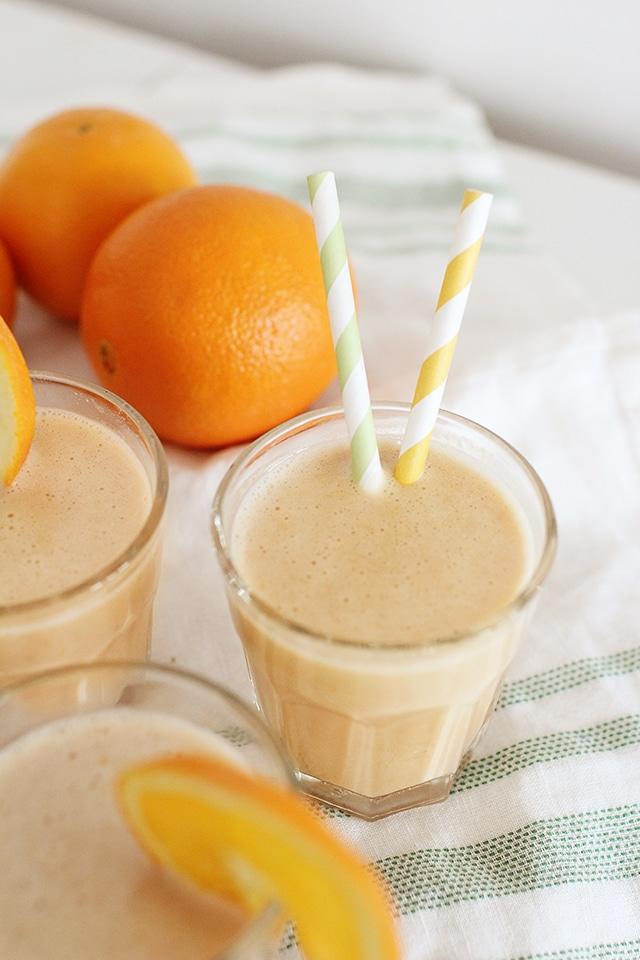 orange julius recipe in glasses with fresh oranges