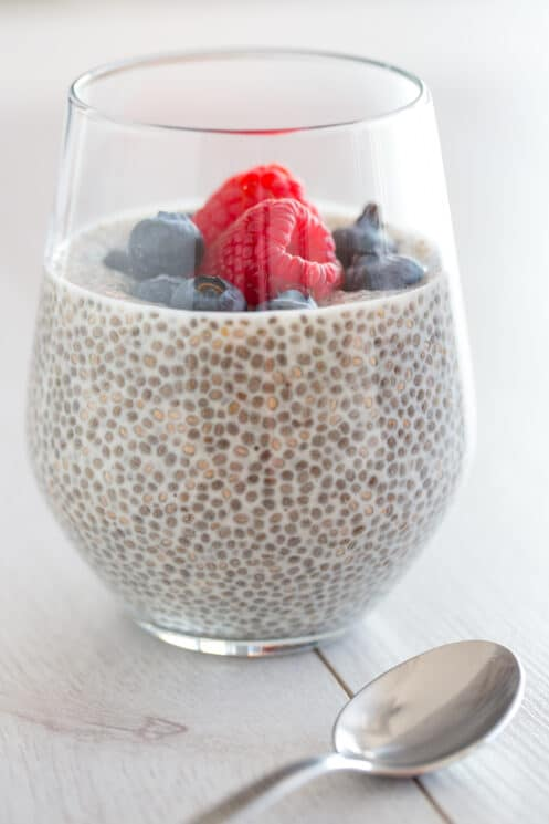 chia pudding in a glass with fresh berries