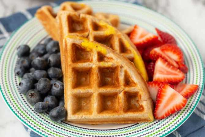 waffle with egg on top and berries