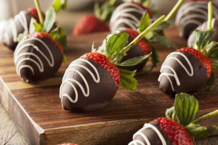 chocolate covered strawberries on a cutting board