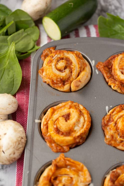 veggie packed pizza rolls in muffin tin