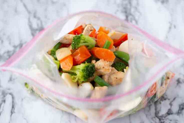 ziplock bag of cooked chicken and veggies for the freezer