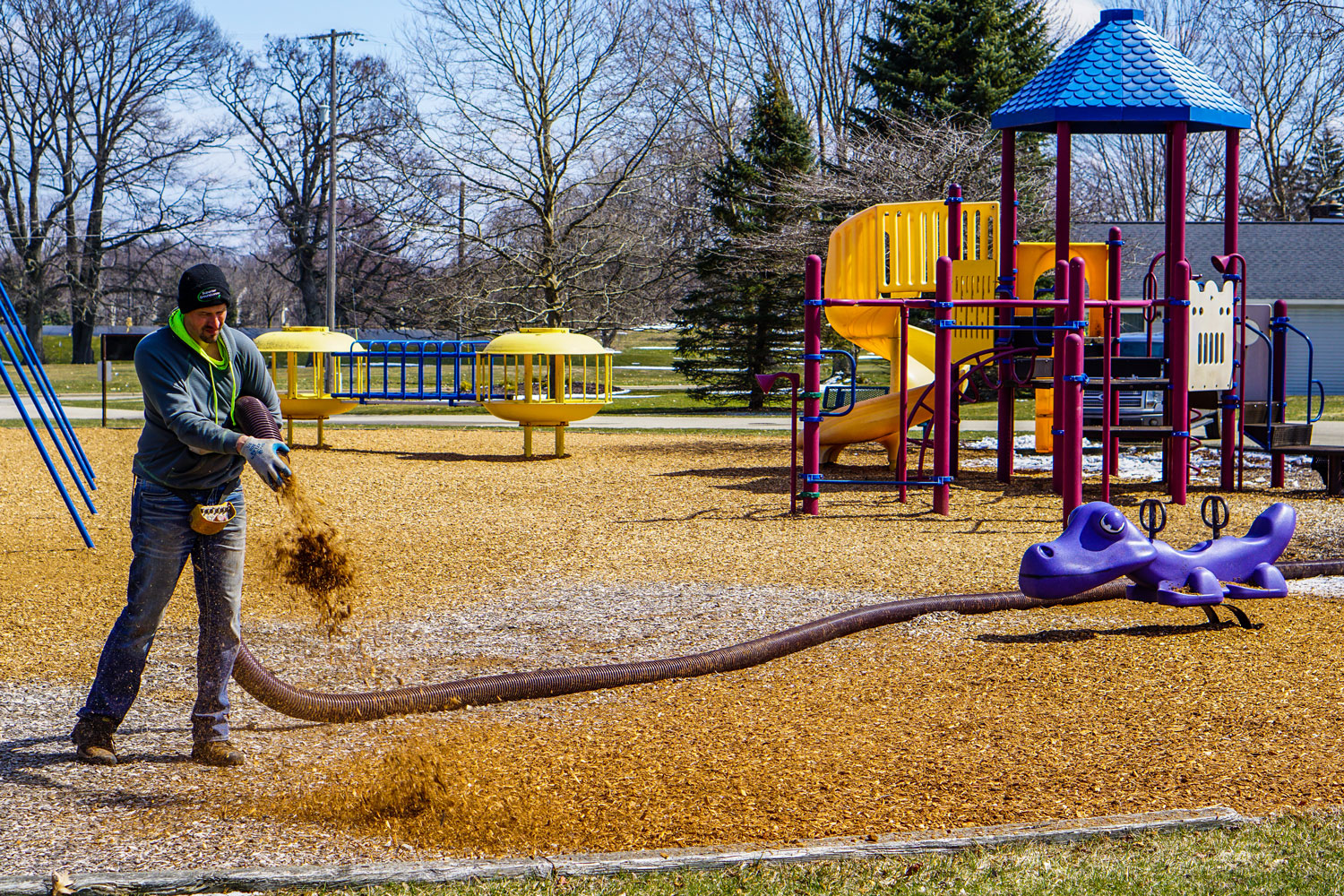 covering a playground in mulch
