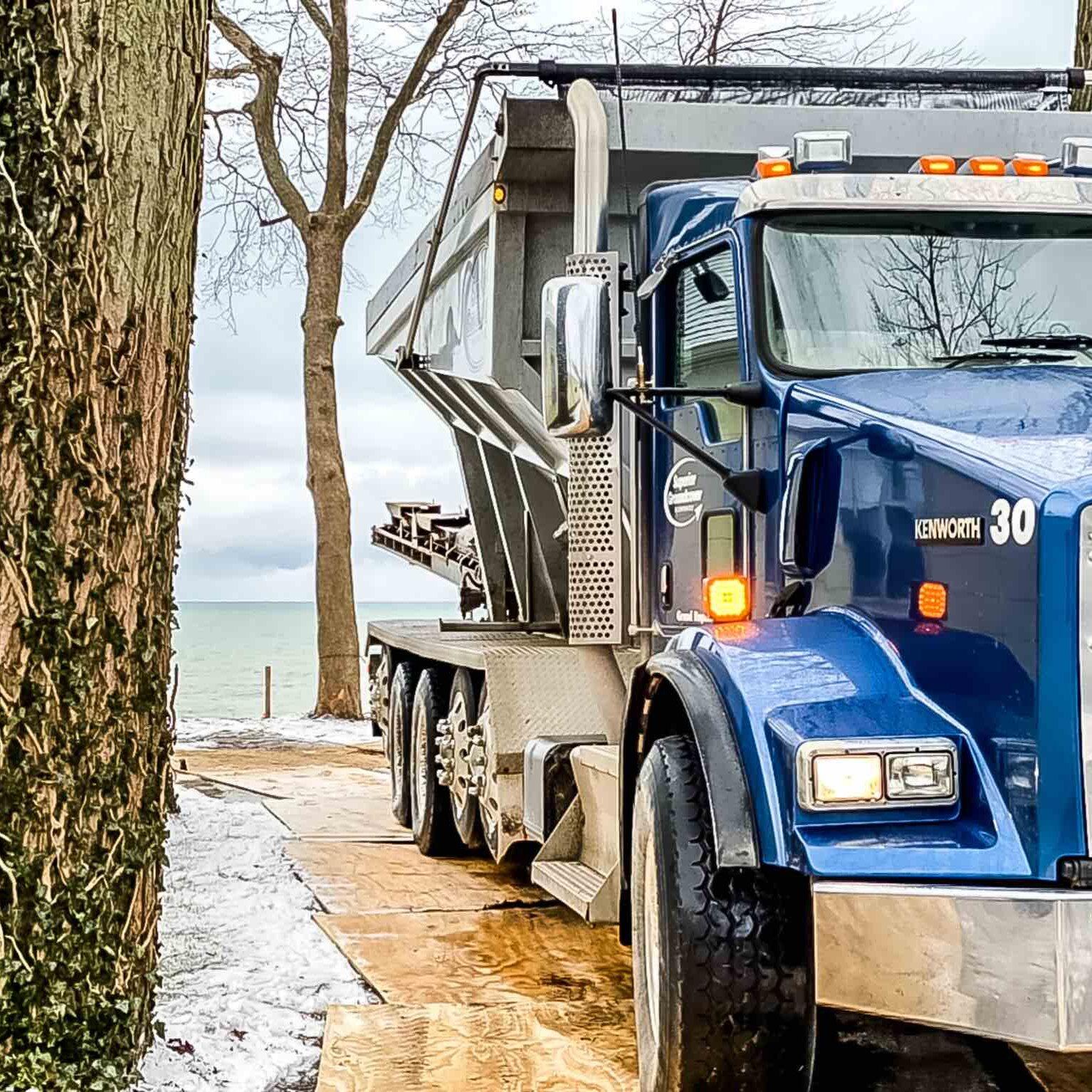Superior stone slinger truck conveying sand