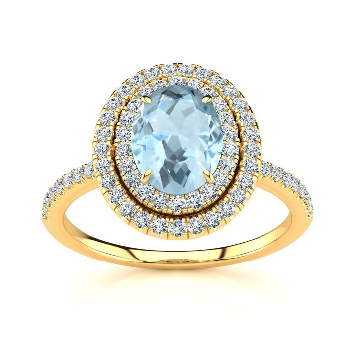 1 1/2 Carat Oval Shape Aquamarine and Double Halo Diamond Ring In 14 Karat Yellow Gold