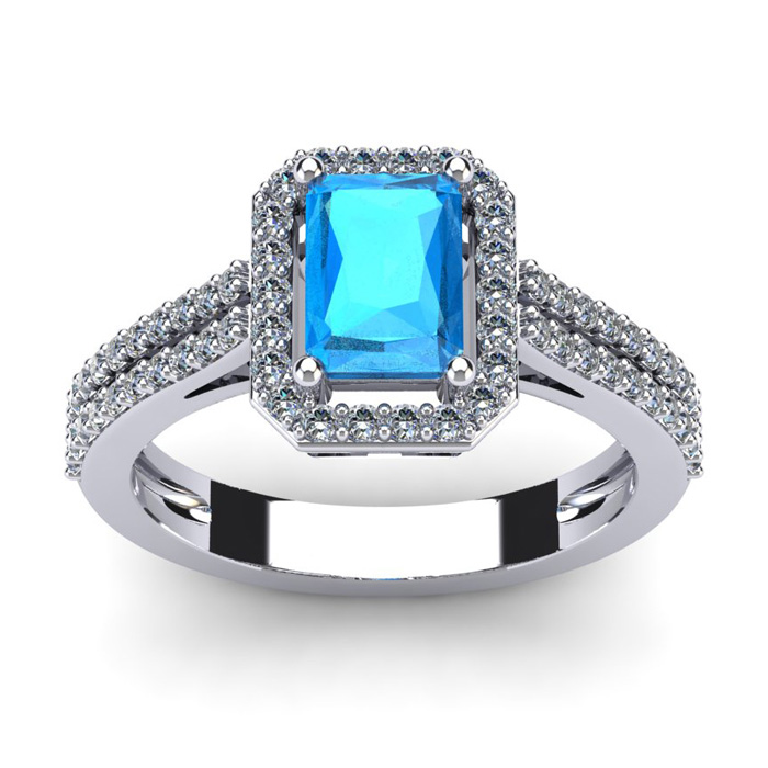 1 1/2 Carat Emerald Cut Blue Topaz and Halo Diamond Ring In 14 Karat White Gold