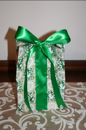 And finally, for this one, rather than handles and a loop and button closure, I sewing on a length of satin ribbon that is tied into a pretty bow to close the gift bag (the inspiration for which came from ones I saw on www.ecowrap.com.)