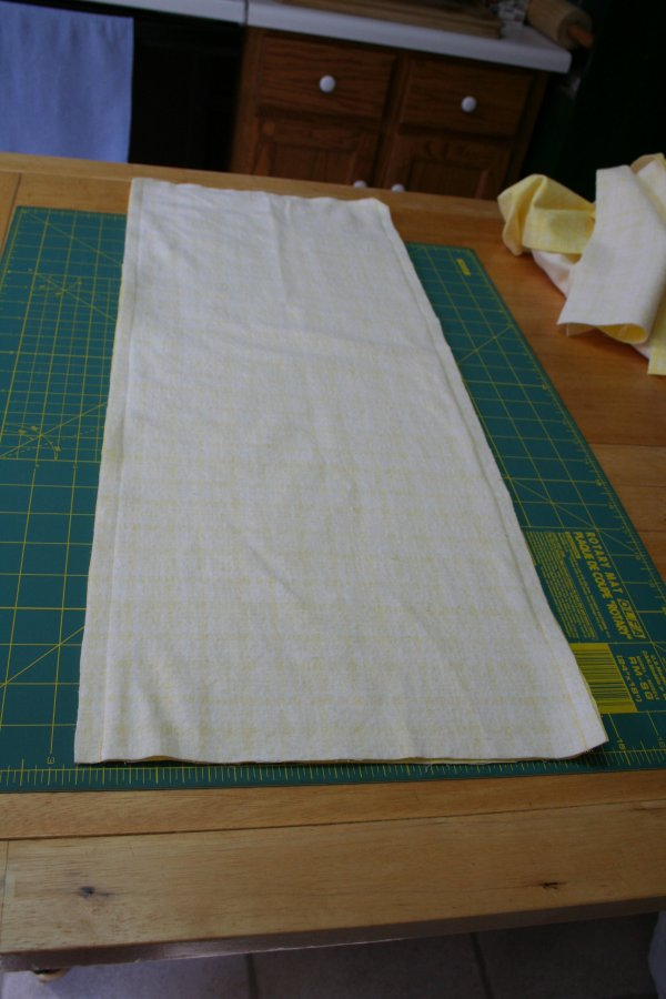 Sew along two long sides and end