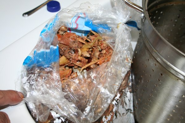 Put bones and cooked veggies, etc in plastic bag and put in garbage