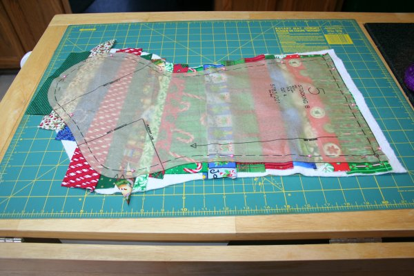 Pin pattern piece over quilting, cut out stocking