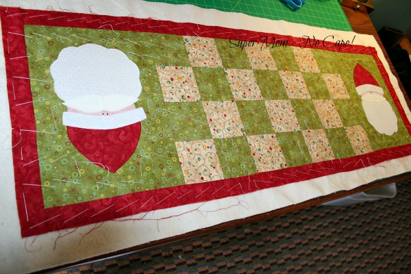 Santa Tablerunner basted and ready to be quilted