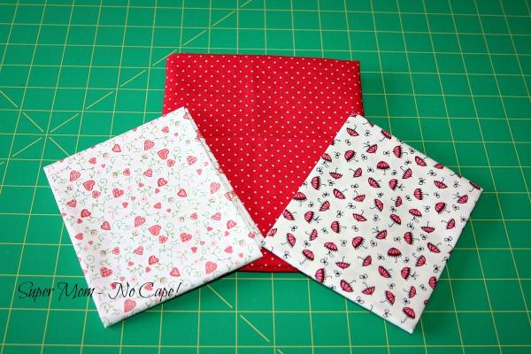 three different red print fabric fat quarters