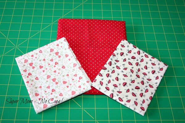 three different red print fabric fat quarters