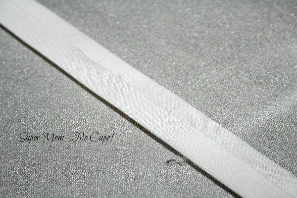Press edges toward the middle crease
