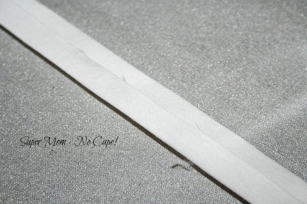 Press edges toward the middle crease