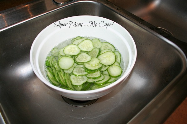 Cucumbers slices covered with salt water