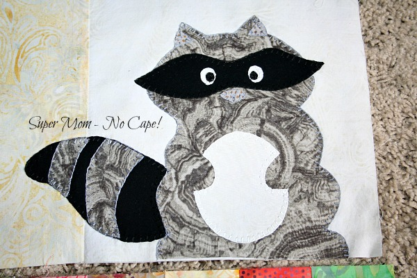 blanket stitched racoon applique for one big cabin quilt